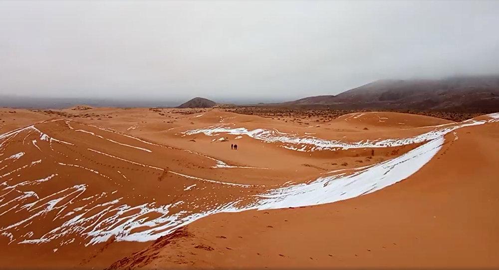 Snow falls in the Sahara Desert