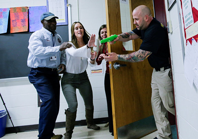 Teachers and staff members take part in an active shooter training at James I O'Neill High School in Highland Falls, New York, U.S., December 12, 2017