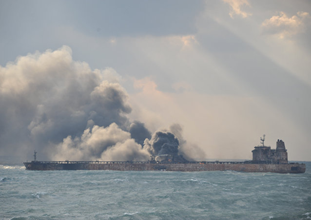 Smoke is seen from the Panama-registered Sanchi tanker carrying Iranian oil, which went ablaze after a collision with a Chinese freight ship in the East China Sea, in this January 9, 2018 handout picture released by China's Ministry of Transport January 10, 2018