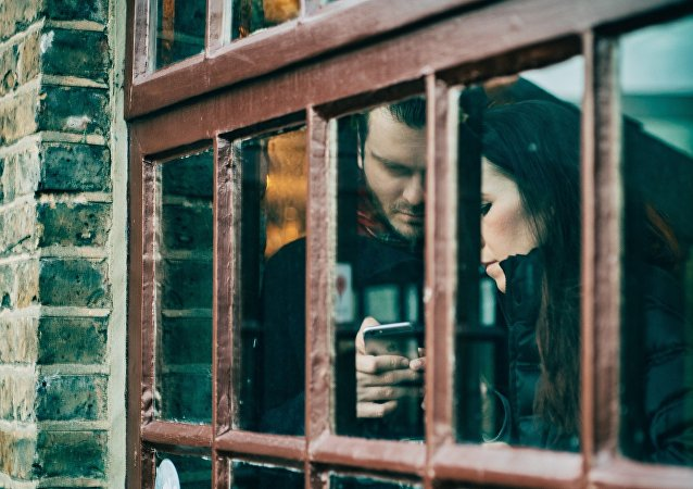 Woman and man with phone