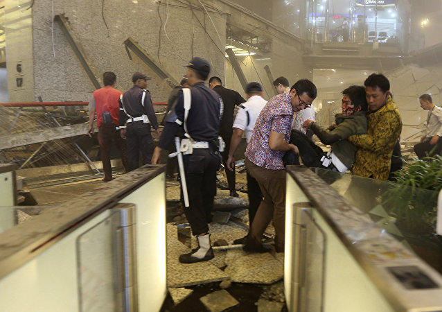 An injured man is carried out of the Jakarta Stock Exchange tower after a floor collapse in Jakarta, Indonesia, Monday, Jan. 15, 2018