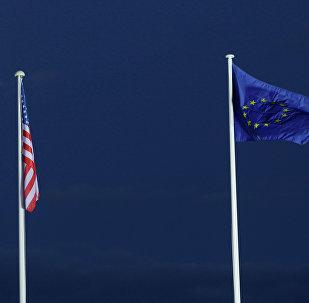 EU and US flags seen beneath the moon