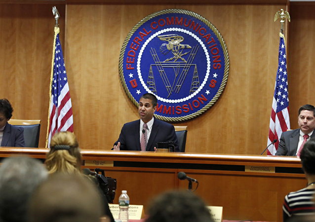Federal Communications Commission (FCC) Chairman Ajit Pai, center, announces the vote was approved to repeal net neutrality, next to Commissioner Mignon Clyburn, left, who voted no, and Commissioner Michael O'Rielly, who voted yes, at the FCC, Thursday, Dec. 14, 2017, in Washington. (File)