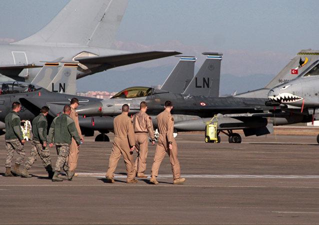 U. S. Air Force airmen walk toward fighter jets after Defense Secretary Ash Carter visited the Incirlik Air Base near Adana, Turkey (File)