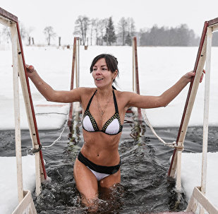 A young woman during the traditional bathing on Orthodox Epiphany Eve (File)