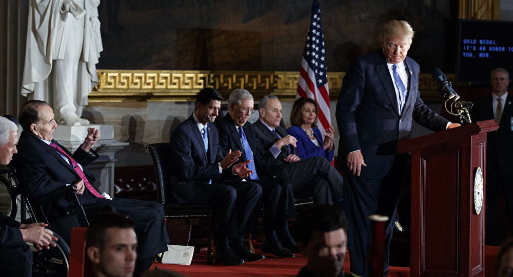 President Donald Trump speaks during a Congressional Gold Medal ceremony honoring former Sen. Bob Dole on Capitol Hill, Wednesday, Jan. 17, 2018, in Washington