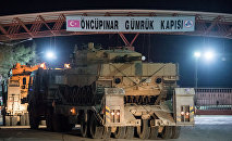 Turkish military vehicles cross into Syria at Oncupinar border gate in Kilis, Turkey, January 20, 2018