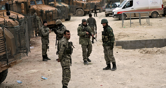 Syrian rockets kill two in Turkey as Ankara fights Kurd militia