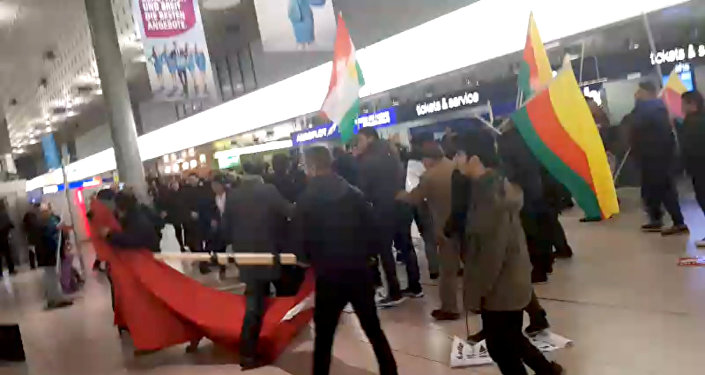 A fight breaks out during a demonstration against Turkish military operation in Syria, in the Hannover Airport, Germany, in this still image taken from a social media video January 22, 2018