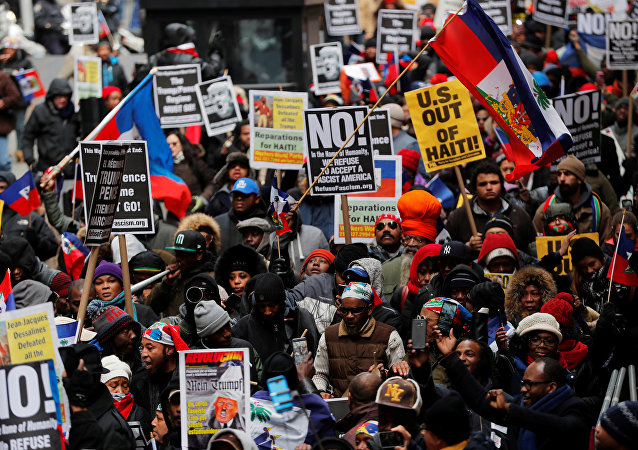 Demonstrators protesting against U.S. President Donald Trump's recent statements about immigration and Haiti march through the Manhattan borough of New York, U.S., January 19, 2018
