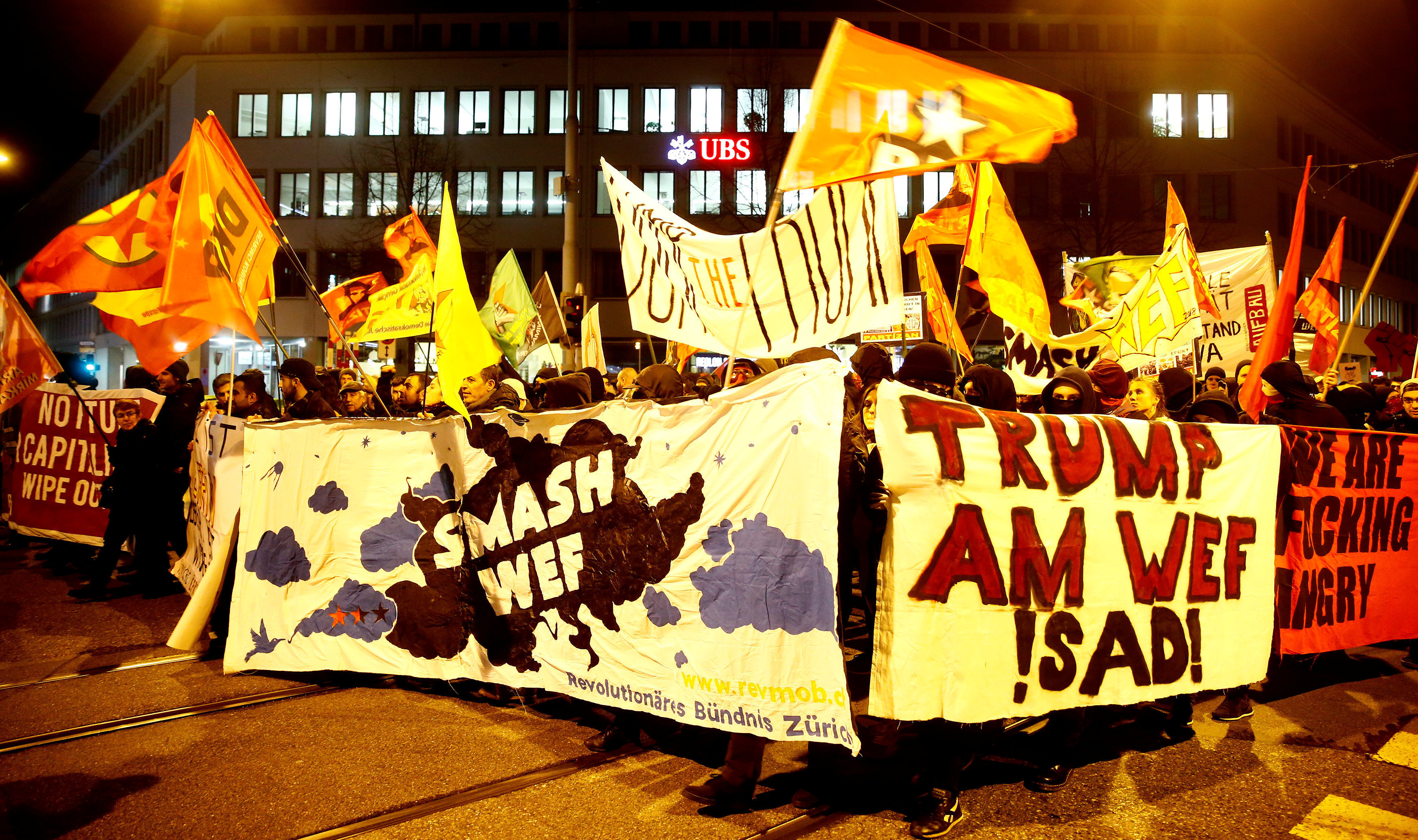 Protesters carry banners during a demonstration against U.S. President Trump in Zurich