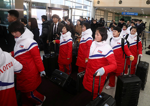 North Korea's women ice hockey athletes arrive at the South's CIQ (Customs, Immigration and Quarantine), just south of the demilitarized zone separating the two Koreas in Paju