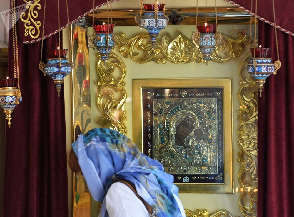 Believers by the Icon of Our Lady of Kazan in the Church of the Exaltation of the Holy Cross at the Kazan Monastery of Our Lady
