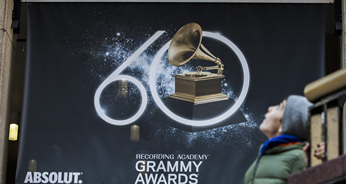 A young boy walks past advertisements promoting the 60th Annual Grammy Awards at the Madison Square Garden in New York