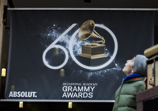 A young boy walks past advertisements promoting the 60th Annual Grammy Awards at the Madison Square Garden in New York on January 26, 2018
