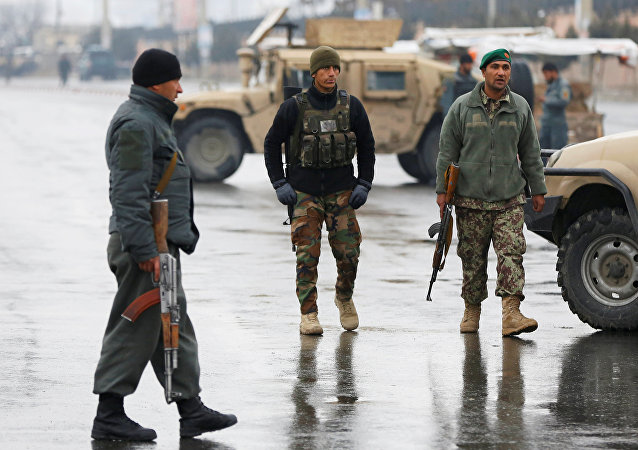 Afghan security forces keep watch near the site of an attack at the Marshal Fahim military academy in Kabul, Afghanistan January 29, 2018