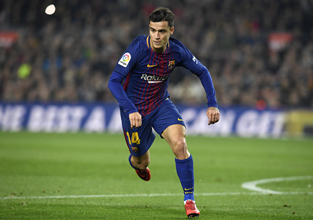 Barcelona's Brazilian midfielder Philippe Coutinho runs during the Spanish 'Copa del Rey' (King's cup) quarter-final second leg football match between FC Barcelona and RCD Espanyol at the Camp Nou stadium in Barcelona on January 25, 2018