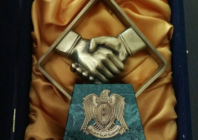 Statuettes symbolizing friendship between Russian and Syria