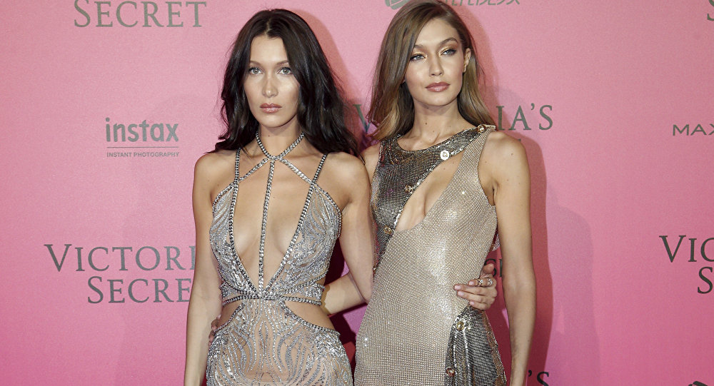 Models Bella Hadid, left, and Gigi Hadid pose during the after party photocall after the Victoria's Secret fashion show Wednesday, Nov. 30, 2016 in Paris.
