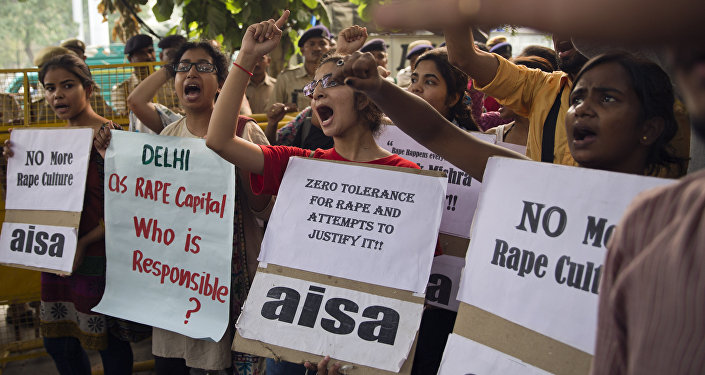 (File) Indian students shout slogans during a protest against the latest incidents of rape in New Delhi, India, Sunday, Oct. 18, 2015