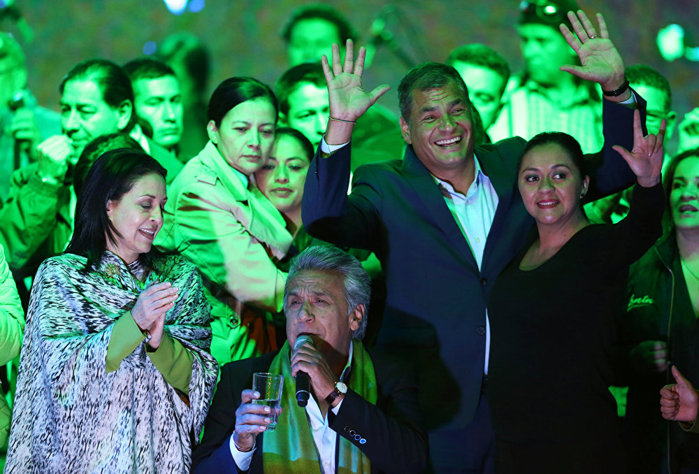 Then Ecuadorean presidential candidate Lenin Moreno (C) gives a speech alongside the then Ecuadorean President Rafael Correa (2nd R) and his wife Rocio Gonzalez (L) during a national election day in a hotel, in Quito, April 2, 2017.