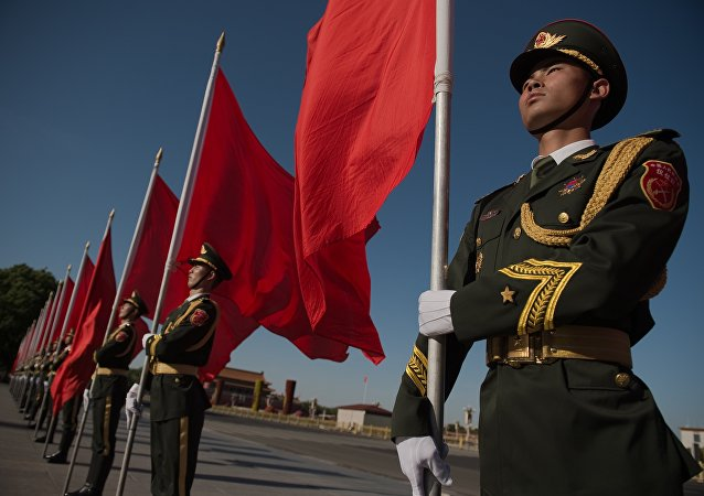 Members of a Chinese military honour guard hold red flags before a welcome ceremony for Afghanistan's Chief Executive Officer Abdullah Abdullah in Beijing on May 16, 2016