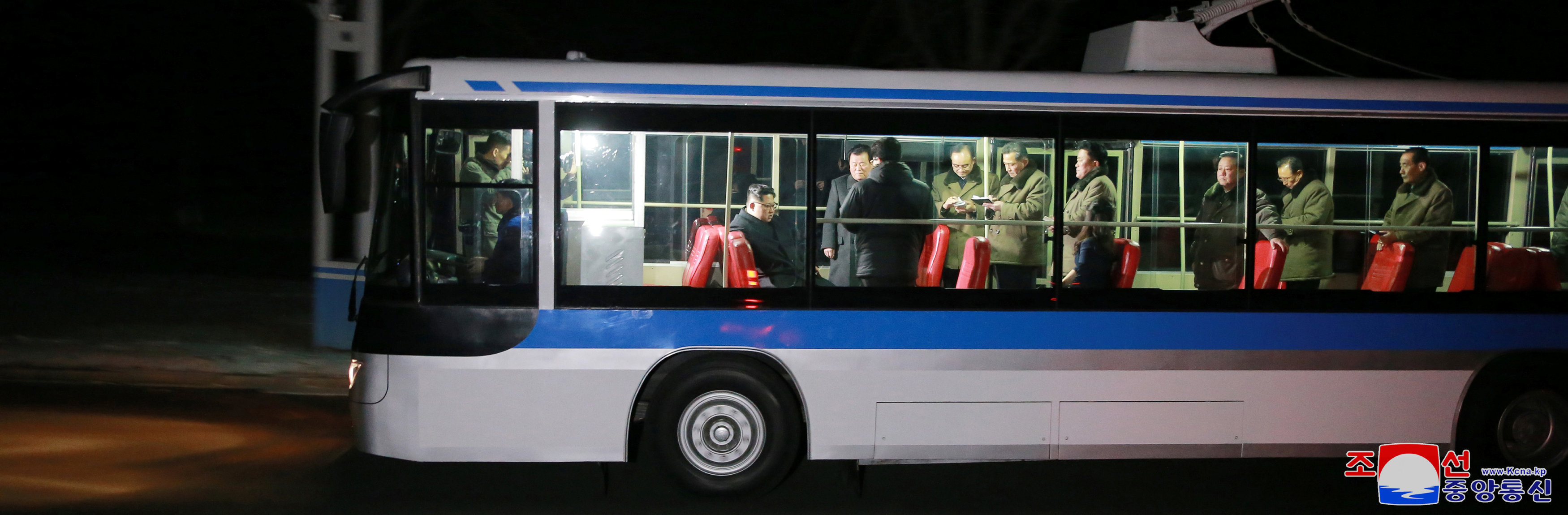 North Korean leader Kim Jong Un and his wife (seated R) are seen during the trial of a trackless tramway, February 4, 2018
