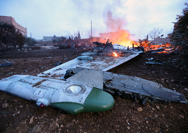 A picture taken on February 3, 2018, shows smoke billowing from the site of a downed Sukhoi-25 fighter jet in Syria's northwest province of Idlib