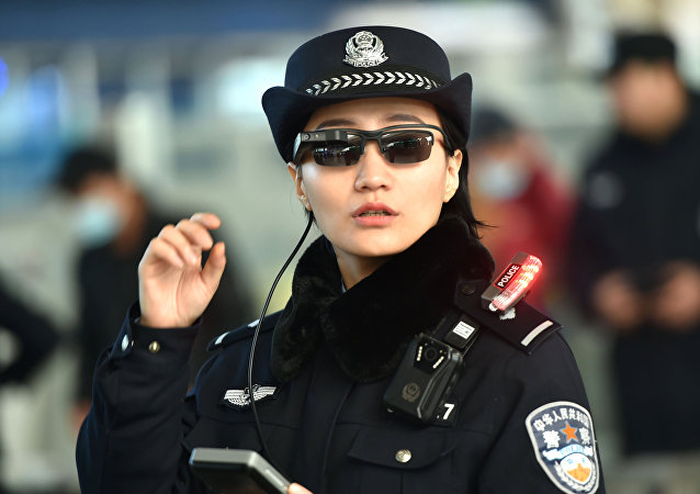 Police officer wearing a pair of smartglasses with a facial recognition system at Zhengzhou East Railway Station in Zhengzhou in China's central Henan province