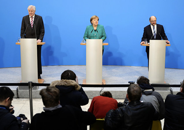 German Chancellor Angela Merkel, Chairwoman of the Christian Democratic Union, CDU, is flanked by Martin Schulz, right, chairman of the Social Democratic Party, SPD, and Bavarian Governor Horst Seehofer, chairman of the Christian Social Union, CSU