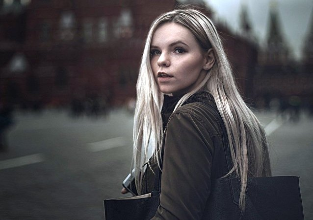 A young woman walking on the Red Square in Moscow