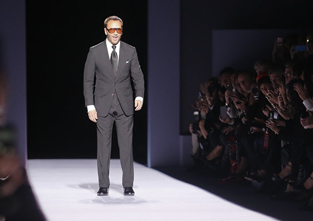 Fashion designer Tom Ford appears on the runway after showing his latest collection during Fashion Week, Thursday Feb. 8, 2018, in New York