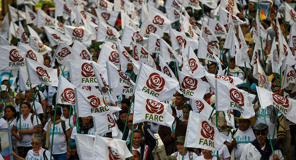 FARC members and supporters wave flags with the new logo of the rebaptized FARC (Common Alternative Revolutionary Force), transformed into a political party following its disarmament, during the closing of their National Congress in Bogota. (File)