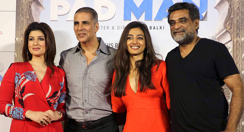 Indian Bollywood actors Twinkle Khanna (L), Akshay Kumar (2L) and Radhika Apte (2R) pose for a photograph during a promotional event for the forthcoming Hindi film 'Padman' written and directed by R. Balki in Mumbai on December 20, 2017.