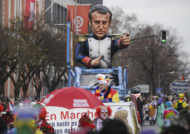 A carnival float depicting France's president Emmanuel Macron is part of the Rose Monday parade in Mainz, Germany