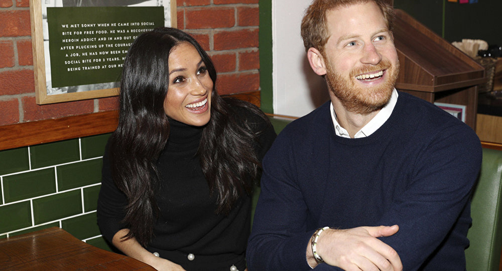Britain's Prince Harry and Meghan Markle speak with patrons at the Social Bite in Edinburgh, Scotland, Tuesday, Feb. 13, 2018.