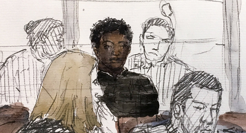 This courtroom sketch created on February 13, 2018 at the courthouse of Pontoise, northwest of Paris, shows a 29-year-old defendant (Rear C) seated in the dock with his lawyers Sandrine Paris-Heidegger (Front L) and Marc Goudarzian (R) during his trial behind closed doors for alleged sexual assault on an 11-year-old girl in April 2017