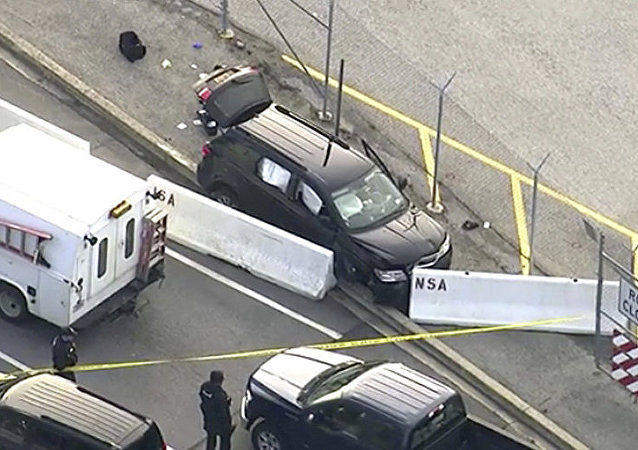 In this image made from video and provided by WUSA TV-9, authorities investigate the scene of a shooting at Fort Meade, Md. on Wednesday, Feb. 14, 2018
