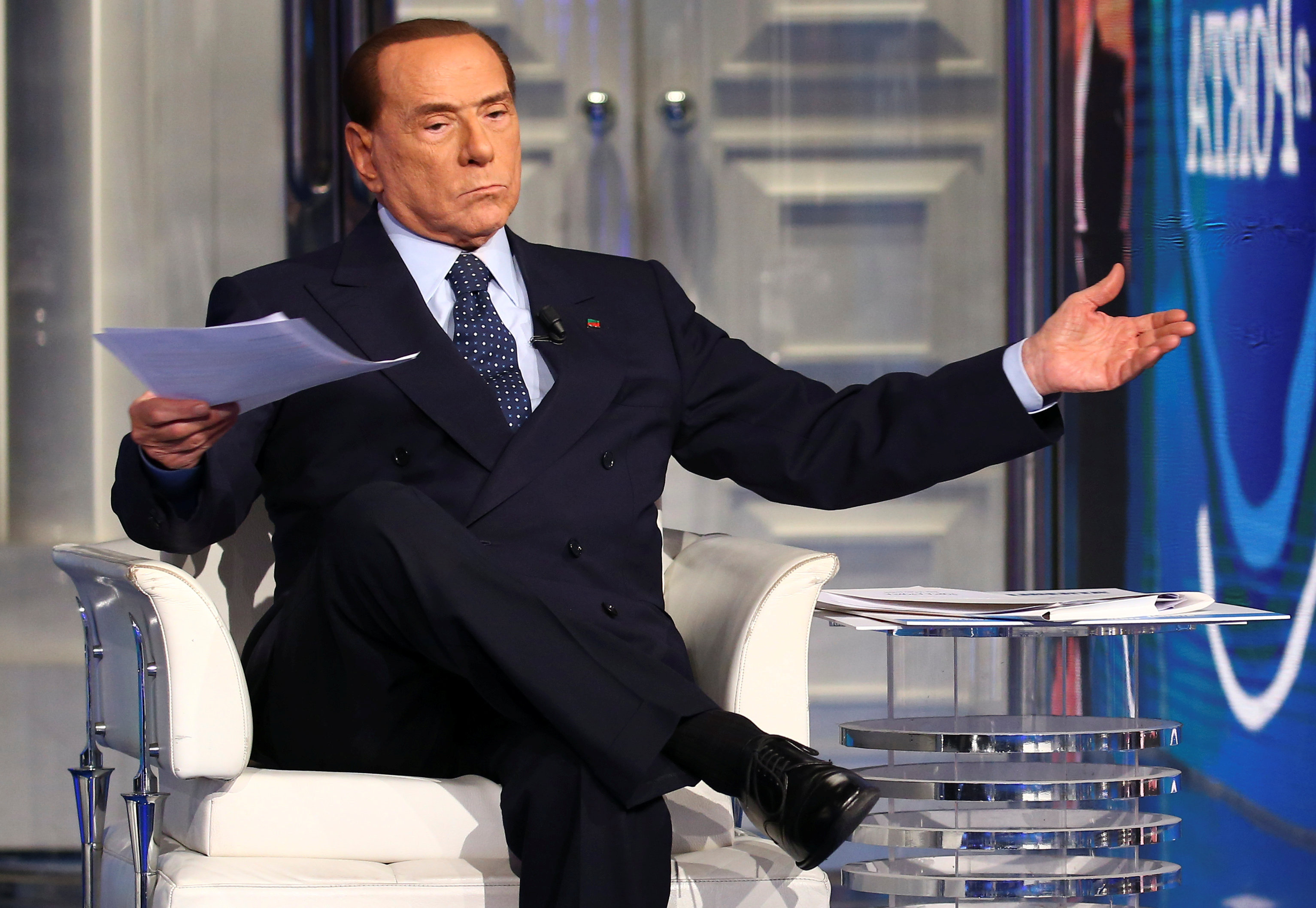 Italy's former Prime Minister Silvio Berlusconi gestures during the taping of the television talk show Porta a Porta (Door to Door) in Rome, Italy, February 14, 2018
