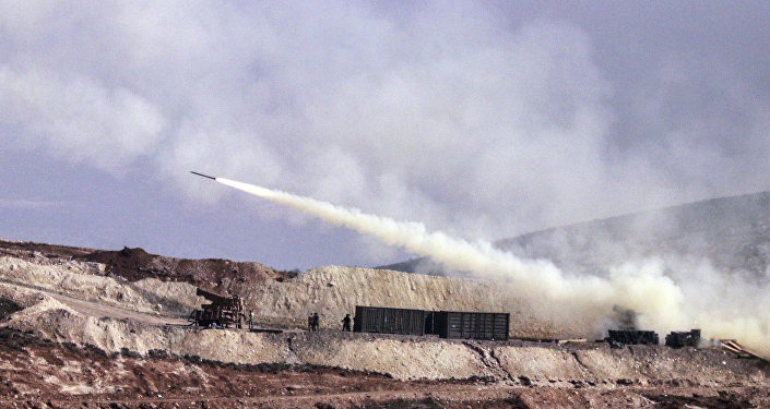 Turkish artillery fires toward Syrian Kurdish positions in Afrin area, Syria, from Turkish side of the border in Hatay, Turkey, Friday, Feb. 9, 2018