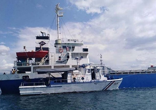 Coast guard ship guards the MV Kudos 1 after pirates attempted to board