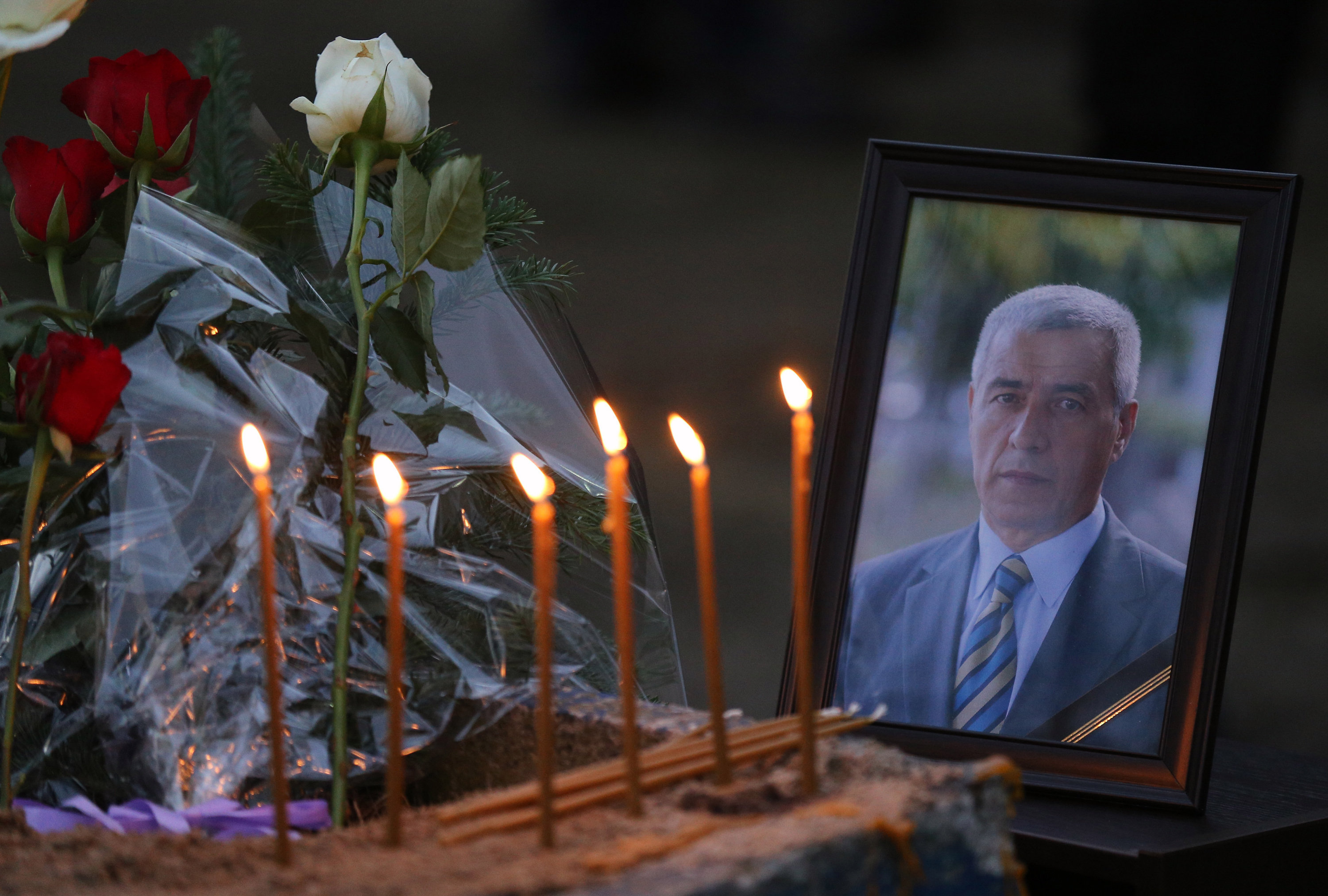 Flowers, candles and a picture of Kosovo Serb politician Oliver Ivanovic, who was shot dead Tuesday morning by still-unknown assailants, at the scene of the shooting in front of his office in the northern, Serb-dominated part of Mitrovica, Kosovo, Tuesday, Jan. 16, 2018