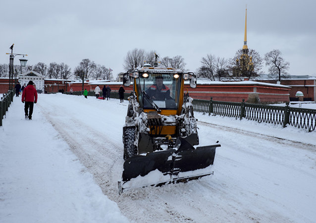 Snow clearing machines at Ioannovsky Bridge, which connects the Peter and Paul Fortress with Petrogradsky Island in St. Petersburg