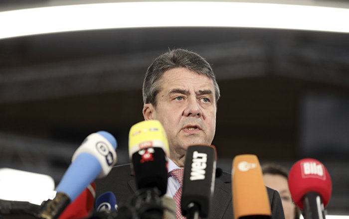 German foreign minister Sigmar Gabriel, delivers a statement about the release of 'Die Welt' journalist Deniz Yucel from prison, in Berlin, Germany, Friday, Feb. 16, 2018. The German reporter detained in Turkey for more than a year was released from jail pending trial, even as six other journalists and newspaper employees were sentenced to life imprisonment by a Turkish court Friday. (Kay Nietfeld/dpa via AP)