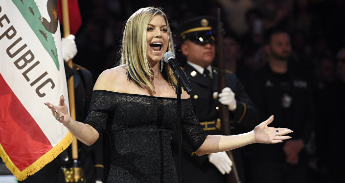 Singer Fergie performs the national anthem prior to an NBA All-Star basketball game, Sunday, Feb. 18, 2018, in Los Angeles