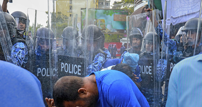 Policemen use pepper spray to disperse pro-opposition supporters during a protest in Male, Maldives