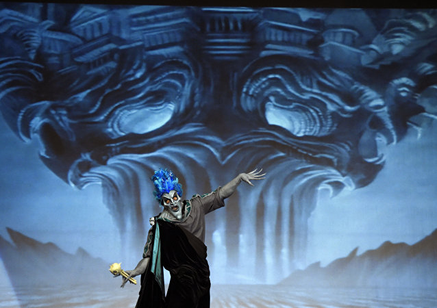 Contestant Jose Davalos performs as Hades from Hercules during the 41st Annual Comic-Con Masquerade costume competition on Saturday, July 11, 2015, in San Diego, Calif.