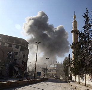 Smoke rises from the rebel held besieged town of Hamouriyeh, eastern Ghouta, near Damascus, Syria, February 21, 2018