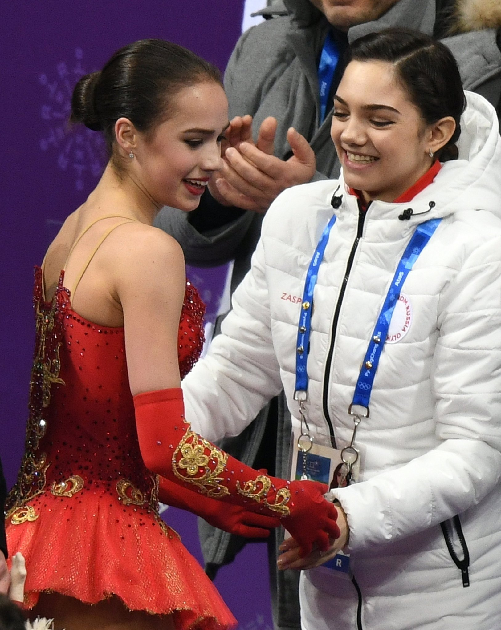 Olympic Athlete from Russia Alina Zagitova, left, after performing her free program during the women's team figure skating competition at the XXIII Olympic Winter Games in Pyeongchang. Right: Russian figure skater Evgenia Medvedeva