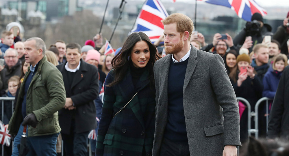 Meghan Markle and Britain's Prince Harry, meet members of the public during a walkabout on the esplanade at Edinburgh Castle, Britain, February 13, 2018